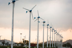 Wind power station against and light sunset Stock Photo