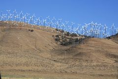 Wind power station. Electricity being generated by wind power stations in a dessert in Nevada Royalty Free Stock Photos