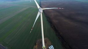 Wind power station in re construction - aerial stock video footage