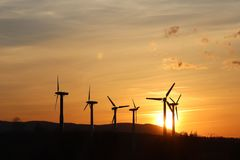 Wind power station in sunset. Romantic evening and modern technologies of ecologically clean electricity. Protection of the enviro. Nment. Bright Future. An stock photography