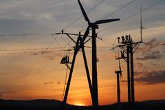 Wind power station in sunset. Romantic evening and modern technologies of ecologically clean electricity. Protection of the enviro. Nment. Bright Future. An stock photos