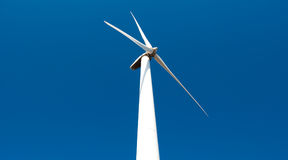 Wind power station - wind turbine against the sky Royalty Free Stock Images