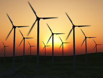 Wind power stations. On a background picturesque sunset Stock Image