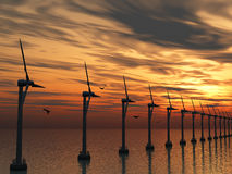 Wind power stations. On water and on a background sunset Royalty Free Stock Image