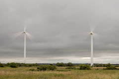 Wind Power Stations Spinning Royalty Free Stock Images