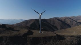 Green technology a clean and renewable energy solution. Wind power technology Aerial drone view on Wind Power. Row of modern wind turbines generating clean stock footage