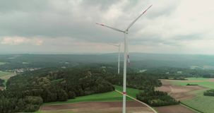 Wind Power Technology. Green power technology, production, clean and renewable energy solution concept. Aerial drone view of summer countryside with wind stock footage