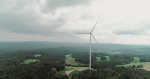 Wind Power Technology. Green power technology, production, clean and renewable energy solution concept. Aerial drone view of summer countryside with wind stock video