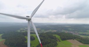 Wind power technology. Green power technology, production, clean and renewable energy solution concept. Aerial drone view of summer countryside with wind stock video footage