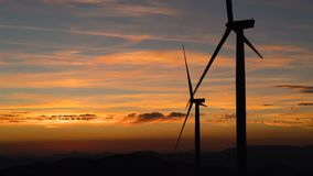 Wind power technology - Turbine, Windmill, Energy Production - Green technology, a clean and renewable energy solution. Time lapse at sunset stock video footage