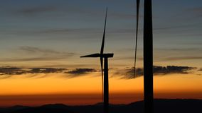 Wind power technology - Turbine, Windmill, Energy Production - Green technology, a clean and renewable energy solution. At sunset stock footage
