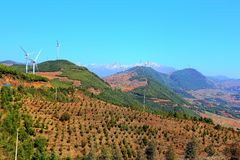 The Wind Power Tower on Dongchuan Red Soil Scenic Area. Dongchuan Red Soil Scenic Area is located in a warm and humid environment. Iron in the soil is slowly stock images