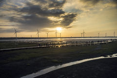 Wind power turbine at Taichung Gaomei wetlands during sunset. Royalty Free Stock Photo