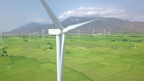 Wind power turbines aerial landscape. Windmill turbine generating clean renewable energy in green agricultural field