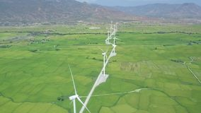 Wind power turbines aerial view. Wind generator for clean renewable energy drone view. Windmill turbine in green field. And mountain landscape. Alternative stock video