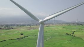 Wind power turbines aerial view. Windmill turbine generating clean renewable energy in green agricultural field aerial. Landscape. Wind energy station. Ecology stock video footage