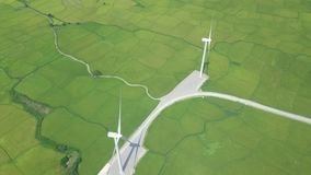 Wind power turbines on green agricultural field drone view. Wind generator on energy station aerial view. Windmill. Turbine for generation natural energy stock video