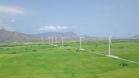 Wind power turbines on green field, mountain landscape drone view. Wind generator for clean renewable energy on power. Station. Windmill turbine, alternative stock video