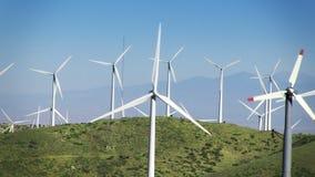 Wind Power Turbines (Green Hills & Blue Sky). Spinning wind turbines on green hills and clear blue sky. Shot on HD 1080p stock video