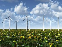 Wind power turbines on a meadow. Wind power turbines on a summer meadow on a beautiful sunny day Stock Photos