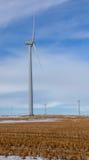 Wind Power. Wind turbines on prairie farmland Royalty Free Stock Image