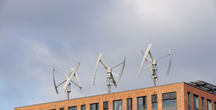 Wind power turbines on a rooftop Royalty Free Stock Photos