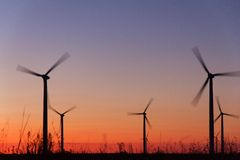 Wind power turbines. At sunset Royalty Free Stock Photo