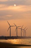 Wind power under sunset Stock Image