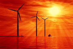 Wind power under sunset Royalty Free Stock Photo