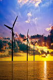 Wind power under sunset Stock Photo