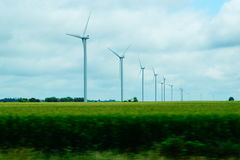 Wind power with wind turbans. A picture of some wind turbans in the corn fields of Kansas Royalty Free Stock Photo