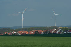 Wind power. Windmills and village in the green Stock Photo
