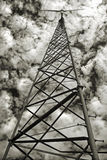 Wind powered generator. Monochrome of a wind-powered electrical generator on a third-world farm, against a rouiling cloudy sky Stock Photography