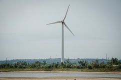 A wind-powered generator at the base of the greener. Y and reservoir Royalty Free Stock Image