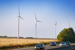 Wind-powered generators along highway Stock Photo
