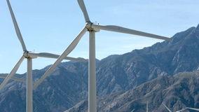 Wind powered generators near Palm Springs, CA. Wind powered generators with mountains in the background near Palm Springs, CA stock footage
