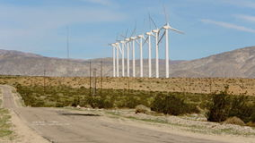 Wind powered generators near Palm Springs, CA. Wind powered windmill generators near Palm Springs, CA with mountains in the background stock footage