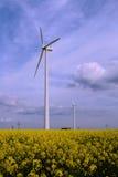 Wind powermills. Windpowermills in a field of rape Stock Images