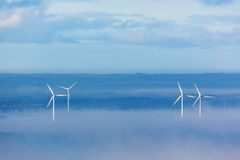 Wind powers in misty landscape Stock Images