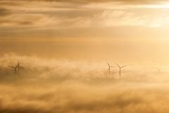 Wind powers in morning mist Stock Photo