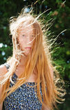 Wind in red hair Stock Images