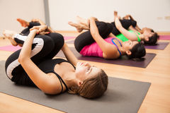 Wind relieving pose in a yoga studio Stock Photography
