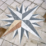 Wind rose. A old wind rose on the floor made with tiles pavement - in italy square Royalty Free Stock Photos