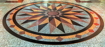 Wind rose compass floor. From marble colour natural stone background Stock Photo