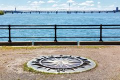 Wind rose compass on saint Helen`s island, saint Lawrence river and Jacoues cartier bridge in Montreal, Quebec, Canada stock photography