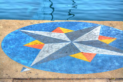 Wind rose painted on Alghero harbor Royalty Free Stock Photo