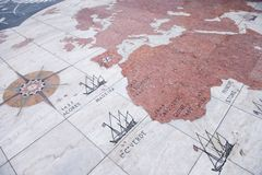 Wind rose on the pavement in Lisbon, Portugal. Tourists view the wind rose on the pavement in front of the monument of Henry the Navigator in the Portuguese Stock Image