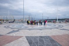 Wind rose on the pavement in Lisbon, Portugal. Tourists view the wind rose on the pavement in front of the monument of Henry the Navigator in the Portuguese Royalty Free Stock Photography