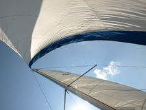 Wind in sails on sailboat. Full sails on a sailboat royalty free stock image