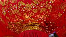 Wind Shakes Slowly Large Red Golden Chinese Lantern Bottom. Closeup macro wind shakes slowly large lacy red golden Chinese lantern bottom at sunlight before